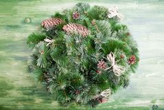 Christmas wreath of pine needles with cones on a green chalkboar Stock Photography