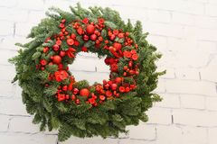 Christmas wreath with pine needles and red apples. And also with red beads and buttons Royalty Free Stock Photo