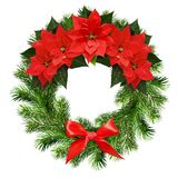 Christmas wreath from pine twigs and poinsettia flowers Stock Images