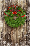 Christmas wreath from pine twigs and red balls on wood Royalty Free Stock Image