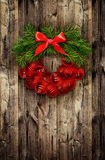 Christmas wreath from pine twigs and red balls Stock Photo