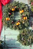 Christmas wreath with pinecones and oranges stock photo