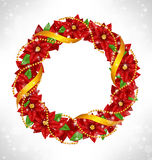 Christmas wreath with poinsettia on grayscale. Shiny Christmas wreath with flowers of poinsettia, golden chains and ribbon in snowfall on grayscale background Royalty Free Stock Images