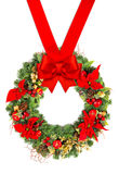 Christmas wreath with poinsettia and red ribbon bow Royalty Free Stock Image