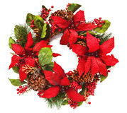 Christmas wreath with poinsettia on white. Closeup of artificail christmas wreath with poinsettia flowers and natural pinecones. Square crop isolated on white stock image