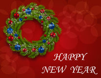 Christmas wreath on a postcard. Green branch of fir with red and blue balls on a red background. Happy New Year Stock Photos