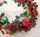 Christmas wreath on quilt Royalty Free Stock Images