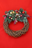 Christmas Wreath on Red. A beautiful Christmas wreath on a bright red background royalty free stock photos