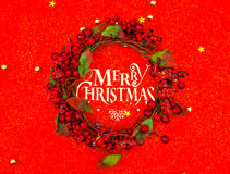Christmas wreath  on red background . Royalty Free Stock Photo