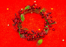 Christmas wreath  on red background . Stock Photo