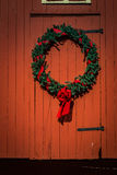 Christmas Wreath on red barn Royalty Free Stock Photo