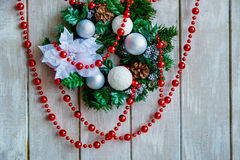 Christmas wreath and red beads decoration Royalty Free Stock Images