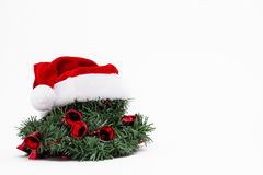 Christmas wreath with red bells and Santa hat Royalty Free Stock Photography