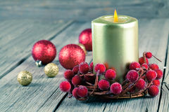 Christmas wreath from red berries with a candle Stock Photo