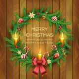 Christmas Wreath with red berries, candles, candy canes, bow, golden bell and balls on wooden board background. Vector stock illustration