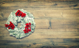 Christmas wreath with red berries. Festive vintage decoration Stock Images