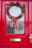 Christmas wreath on red door Stock Image