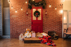 Christmas wreath on red door Royalty Free Stock Images