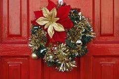 Christmas Wreath on Red Door Stock Photos