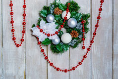 Christmas wreath and red garland Stock Photos