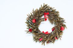 Christmas wreath with red ornaments on the wall Royalty Free Stock Image