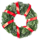 Christmas wreath with red ribbon Stock Images