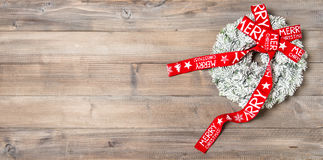 Christmas wreath with red ribbon. Festive ornament Stock Images