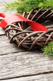 Christmas wreath with red ribbon. And fir branch stock images