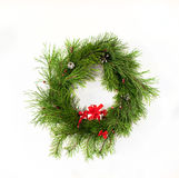 Christmas wreath with red ribbon and gift box Stock Photo
