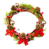 Christmas wreath with red ribbon,pine cones and golden decorati. On isolated on white royalty free stock image
