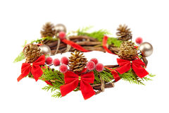 Christmas wreath with red ribbon,pine cones and golden decoratio Stock Images