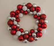 Christmas Wreath. Red and white Christmas Wreath decoration on white wall stock image