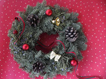 Christmas wreath on red and white polka dots Royalty Free Stock Photo