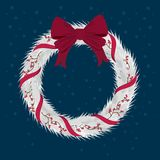 Christmas Wreath with ribbons with red bow. Royalty Free Stock Photos