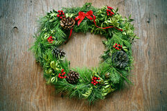 Christmas wreath on a rustic door Royalty Free Stock Image