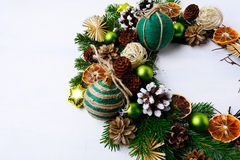 Christmas wreath with rustic handmade straw stars and pine cones Royalty Free Stock Photo