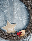 Christmas Wreath. Rustic Christmas wreath in winter snow royalty free stock image