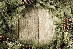 Christmas Wreath with Rustic Wood Stock Images