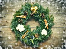 Christmas wreath on the wooden background Royalty Free Stock Images