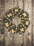 Christmas wreath on a rustic wooden front door Royalty Free Stock Images