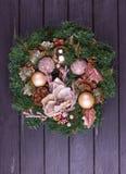 Christmas wreath on a rustic wooden front door. Christmas wreath on a rustic wooden black front door Stock Photo