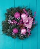 Christmas wreath on a rustic wooden front door. Christmas wreath on a rustic blue wooden front door Stock Image