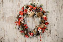 Christmas wreath on a rustic wooden front door. Christmas wreath on a rustic wooden front door close up Royalty Free Stock Images
