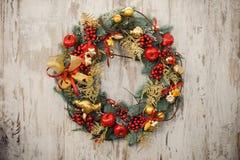 Christmas wreath on a rustic wooden front door. Close up christmas wreath on a rustic wooden front door Royalty Free Stock Photos