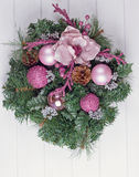 Christmas wreath on a rustic wooden front door. Royalty Free Stock Images