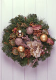 Christmas wreath on a rustic wooden front door. Stock Images