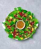 Christmas Wreath Salad with Pomegranate, Avocado, Salad Mix, Almond and Honey-Mustard Dressing, Healthy Eating stock images