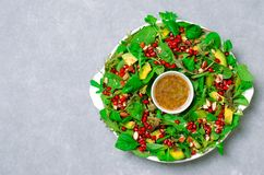 Christmas Wreath Salad with Pomegranate, Avocado, Salad Mix, Almond and Honey-Mustard Dressing, Healthy Eating stock photography