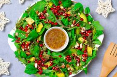 Christmas Wreath Salad with Pomegranate, Avocado, Salad Mix, Almond and Honey-Mustard Dressing, Healthy Eating royalty free stock photos