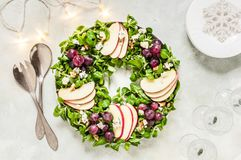 Christmas Wreath Salad. Spinach and Corn Salad, Apple, Blue Cheese, Grapes and Honey Dressing royalty free stock photo